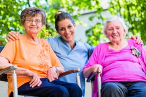 Geriatric nurse having chat with senior women